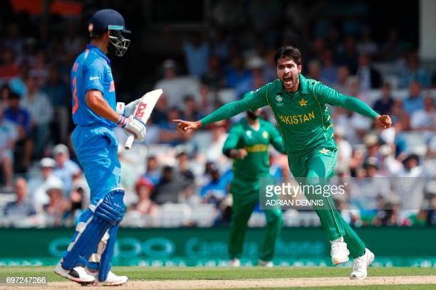 TOPSHOT Pakistan's Mohammad Amir celebrates after taking the wicket of India's captain Virat Kohli during the ICC Champions Trophy final cricket...