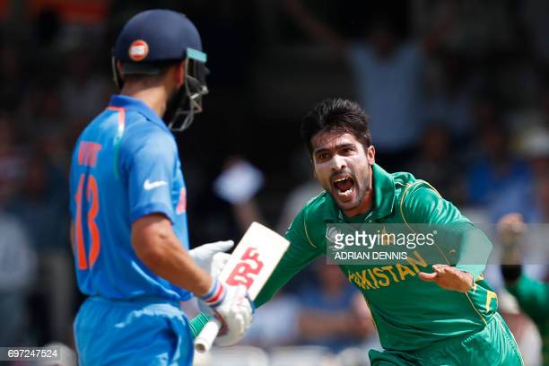 Pakistan's Mohammad Amir celebrates after taking the wicket of India's captain Virat Kohli during the ICC Champions Trophy final cricket match...