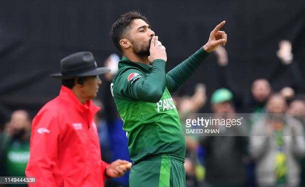 Pakistan's Mohammad Amir celebrates after the dismissal of Australia's captain Aaron Finch during the 2019 Cricket World Cup group stage match...