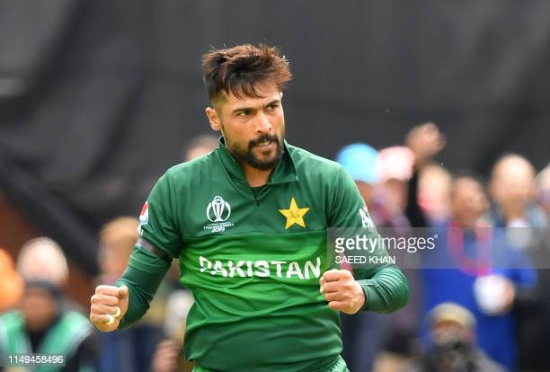 Pakistan's Mohammad Amir celebrates after the dismissal of Australia's Alex Carey during the 2019 Cricket World Cup group stage match between...