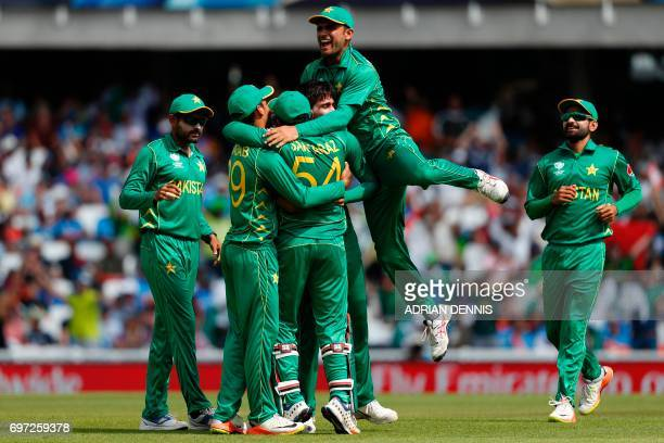 TOPSHOT Pakistan's Mohammad Amir celebrates with teammates after taking the wicket of India's Shikhar Dhawan for 21 during the ICC Champions Trophy...