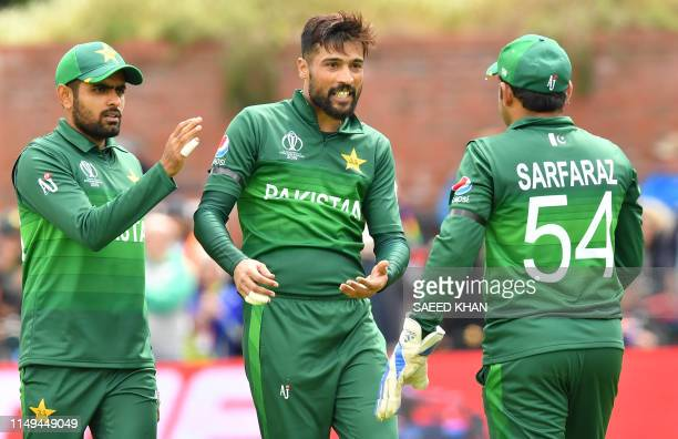 Pakistan's Mohammad Amir celebrates with teammates after the dismissal of Australia's Alex Carey during the 2019 Cricket World Cup group stage match...