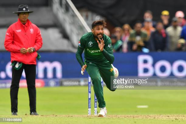 Pakistan's Mohammad Amir reacts after a delivery during the 2019 Cricket World Cup group stage match between Australia and Pakistan at The County...