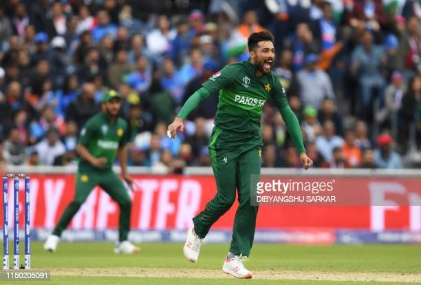 Pakistan's Mohammad Amir reacts after a delivery during the 2019 Cricket World Cup group stage match between India and Pakistan at Old Trafford in...