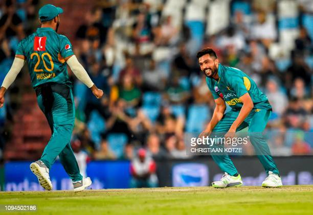 Pakistan's Mohammad Amir reacts after taking the wicket of South Africa's Heinrich Klaasen during the third and final Twenty20 international cricket...