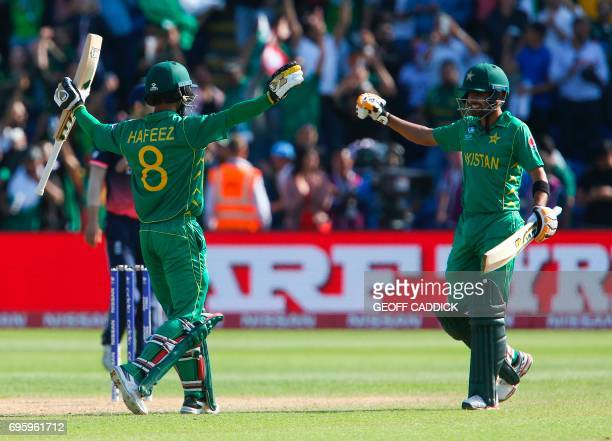 Pakistan's Mohammad Hafeez and Pakistan's Babar Azam celebrate after winning the ICC Champions Trophy semifinal cricket match between England and...