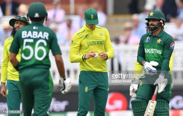 Pakistan's Mohammad Hafeez and Pakistan's Babar Azam look on during the 2019 Cricket World Cup group stage match between Pakistan and South Africa at...