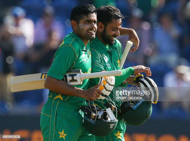 Pakistan's Mohammad Hafeez and Pakistan's Babar Azam walks back to the pavilion after Pakistan won the ICC Champions Trophy semifinal cricket match...