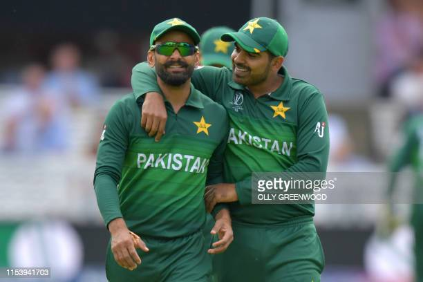 Pakistan's Mohammad Hafeez and Pakistan's Haris Sohail share a light moment during the 2019 Cricket World Cup group stage match between Pakistan and...