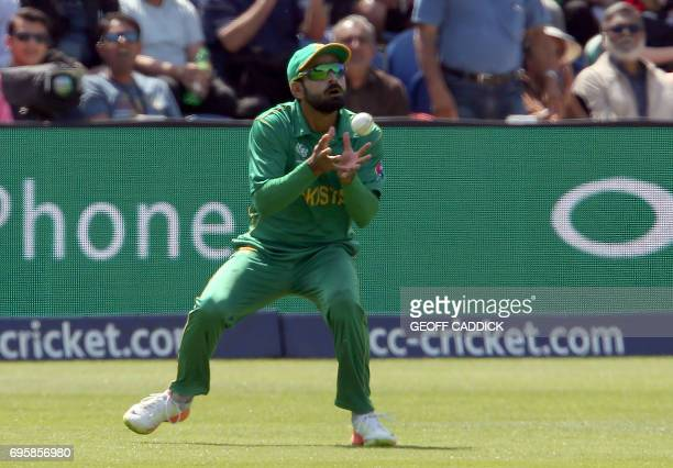 Pakistan's Mohammad Hafeez catches a ball to take the wicket of England's Jonny Bairstow for 43 runs during the ICC Champions Trophy semifinal...