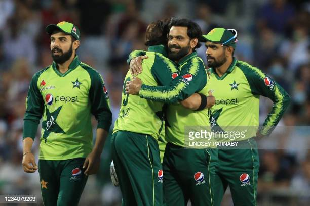 Pakistan's Mohammad Hafeez celebrates with team mates after taking the wicket of England's Moeen Ali for 1 during the third T20 international cricket...