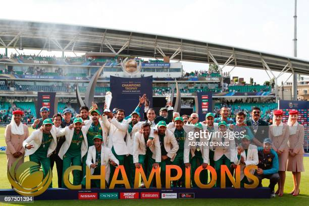 CORRECTION Pakistan's Mohammad Hafeez lifts the trophy as Pakistan players celebrate their win at the presentation after the ICC Champions Trophy...