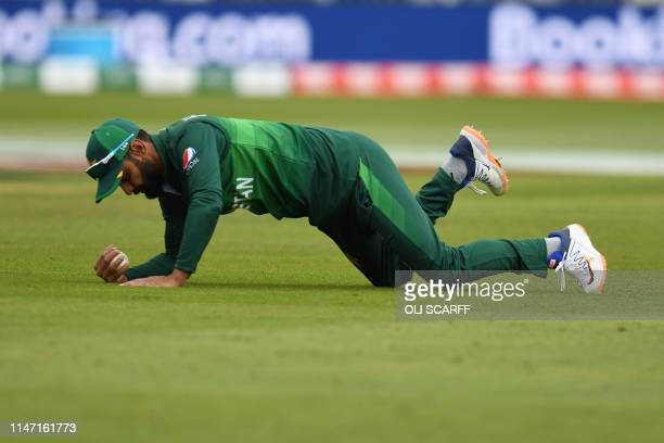 TOPSHOT Pakistan's Mohammad Hafeez makes the catch to dismiss West Indies' Shai Hope for 11 during the 2019 Cricket World Cup group stage match...