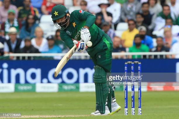 TOPSHOT Pakistan's Mohammad Hafeez plays a shot during the 2019 Cricket World Cup group stage match between England and Pakistan at Trent Bridge in...