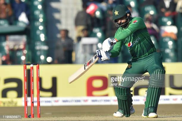 Pakistan's Mohammad Hafeez plays a shot during the first T20 international cricket match of a threematch series between Pakistan and Bangladesh at...