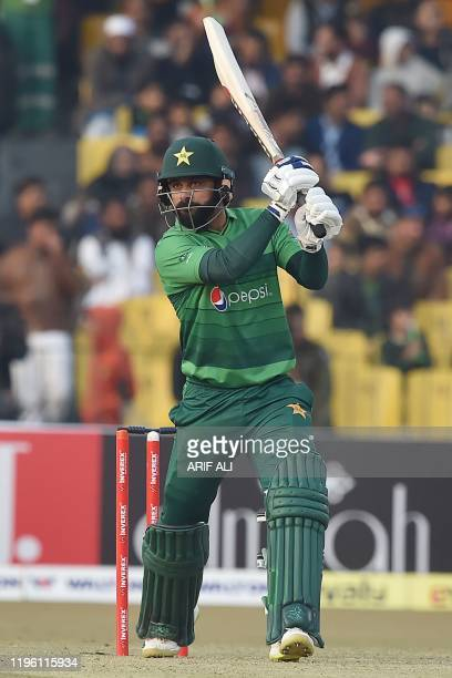 Pakistan's Mohammad Hafeez plays a shot during the second T20 international cricket match of a threematch series between Pakistan and Bangladesh at...