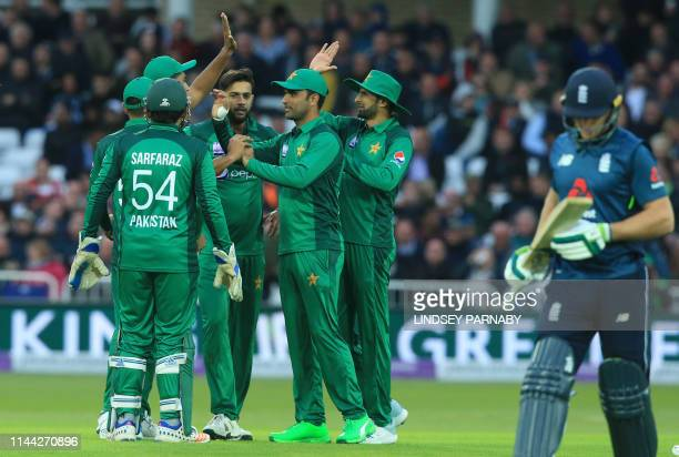 Pakistan's Mohammad Hasnain celebrates with teammates after taking England's Jason Roy's wicket for 114 runs during the fourth One Day International...