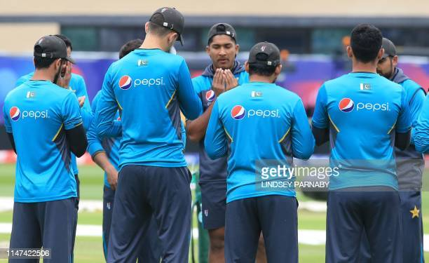 Pakistan's Mohammad Hasnain prays with teammates as they take part in a training session at Trent Bridge in Nottingham central England on June 2 on...