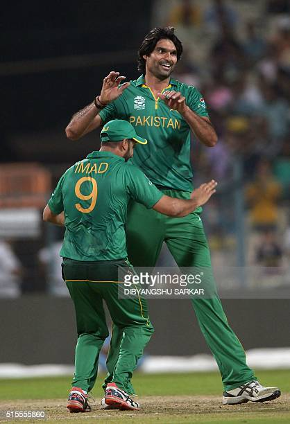 Pakistan's Mohammad Irfan with teammate Imad Wasim celebrate after the dismissal of Sri Lanka's Thisara Perera during a practice match between...