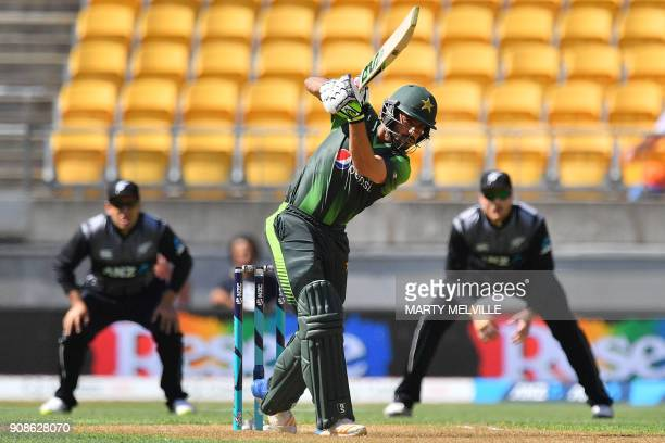 Pakistan's Mohammad Nawaz bats watched by New Zealand's Ross Taylor and Martin Guptill during the first Twenty20 international cricket match between...