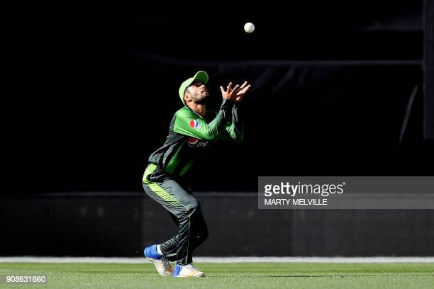 Pakistan's Mohammad Nawaz catches New Zealand's Martin Guptill during the first Twenty20 international cricket match between New Zealand and Pakistan...