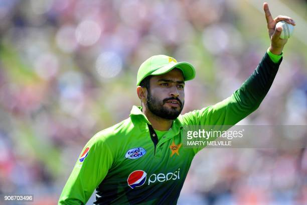Pakistan's Mohammad Nawaz celebrates catching New Zealand's Colin Munro during the 5th one day international cricket match between New Zealand and...