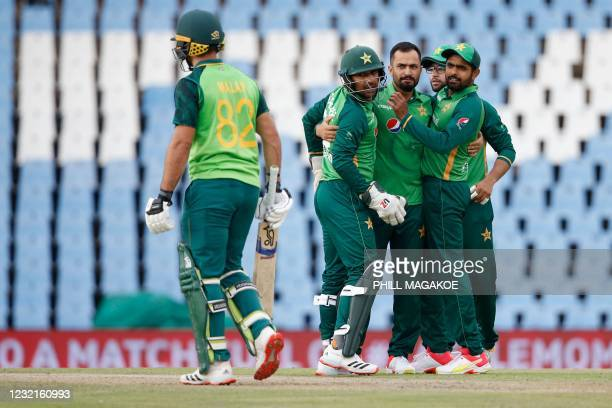 Pakistan's Mohammad Nawaz celebrates with teammates after the dismissal of South Africa's Janneman Malan during the third one-day international...