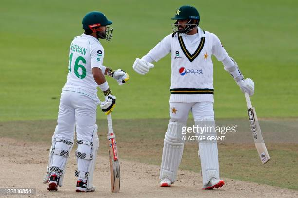 Pakistan's Mohammad Rizwan and Pakistan's Azhar Ali chat in the middle during play on the third day of the third Test cricket match between England...