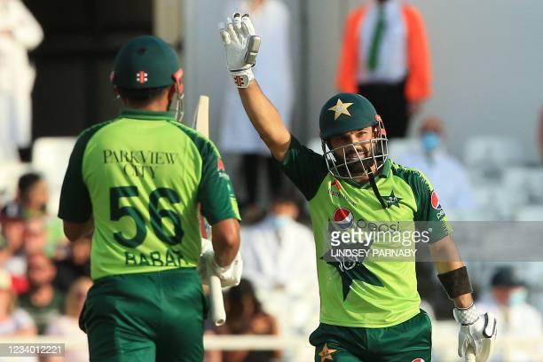 Pakistan's Mohammad Rizwan celebrates his half century during the T20 cricket match between England and Pakistan at Trent Bridge, Nottingham, England...