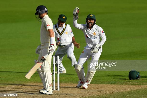 Pakistan's Mohammad Rizwan celebrates taking the wicket of England's Joe Root for 14 runs during play on the second day of the first Test cricket...