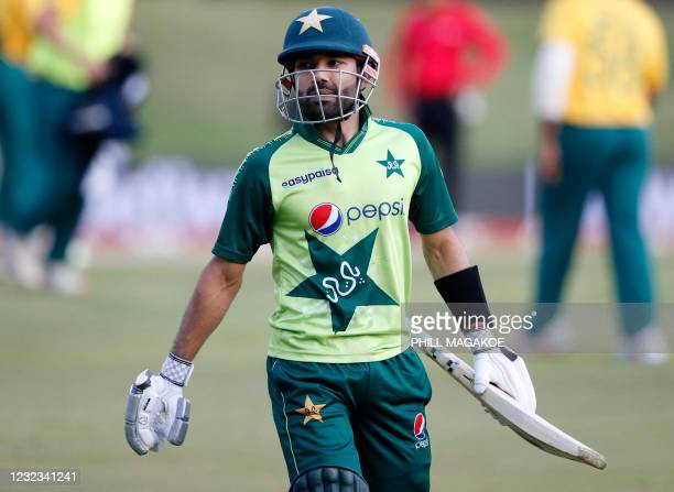Pakistan's Mohammad Rizwan reacts as he walks back to the pavilion after his dismissal during the fourth Twenty20 international cricket match between...