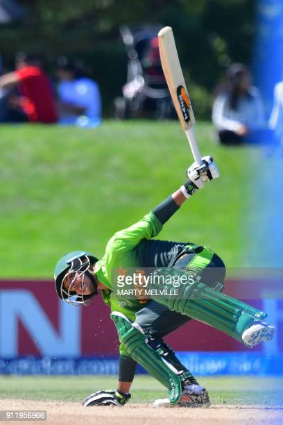 Pakistan's Mohammad Taha looses his balance during the U19 semifinal cricket World Cup match between India and Pakistan at Hagley Oval in...