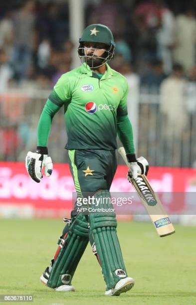 Pakistan's Mohammed Hafeez leaves the field after being dismissed during the fourth one day international cricket match between Sri Lanka and...