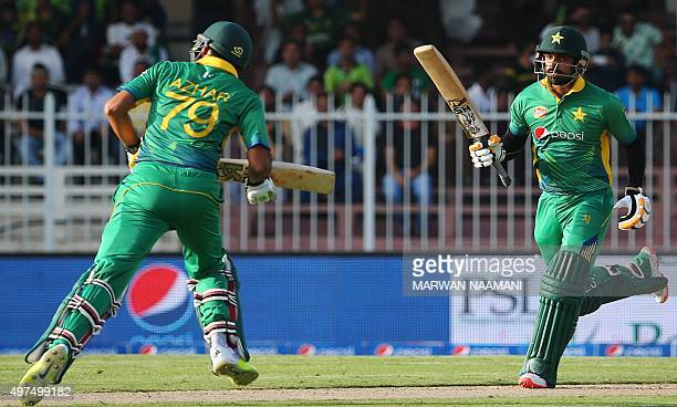 Pakistan's Muhammad Hafeez and Azhar Ali run between wickets during the third One Day International match between Pakistan and England at The Sharjah...