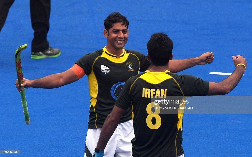 7abe50ac024 Pakistan s Muhammad Irfan (R) and Muhammad Imran celebrate scoring a goal  during their Hero