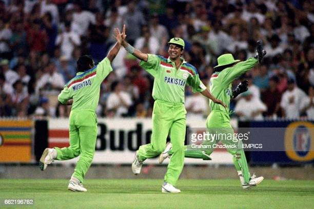 Pakistan's Mushtaq Ahmed Wasim Akram and Moin Khan celebrate the fall of an English wicket