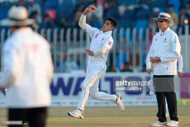 TOPSHOT Pakistan's Naseem Shah delivers the ball during the third day of the first cricket Test match between Pakistan and Bangladesh at the...