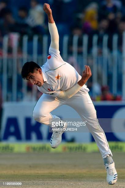 Pakistan's Naseem Shah delivers the ball during the third day of the first cricket Test match between Pakistan and Bangladesh at the Rawalpindi...
