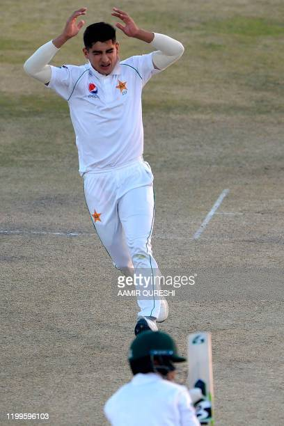 Pakistan's Naseem Shah reacts after delivering the ball during the third day of the first cricket Test match between Pakistan and Bangladesh at the...