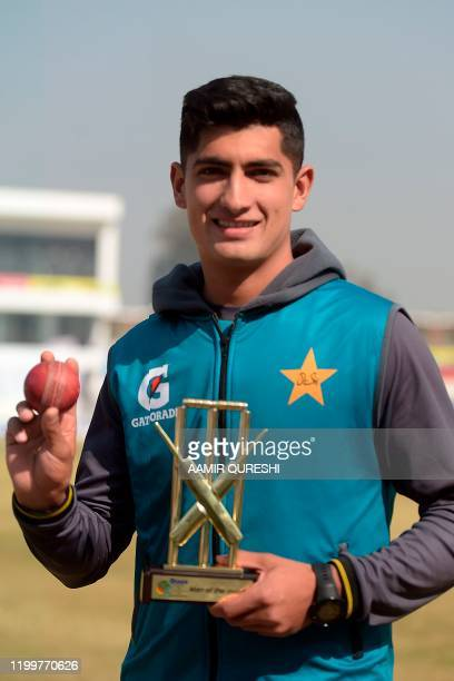 Pakistan's Naseem Shah who yesterday got a hattrick holds a ball and an award after Pakistan won the first cricket Test match against Bangladesh at...