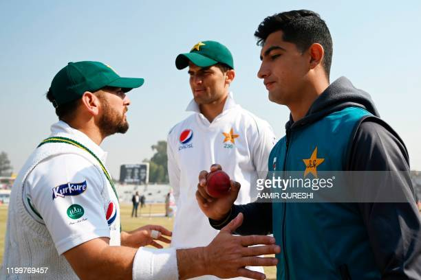 Pakistan's Naseem Shah who yesterday got a hattrick holds a ball next to teammates Shaheen Shah Afridi and Yasir Shah at the end of the first cricket...