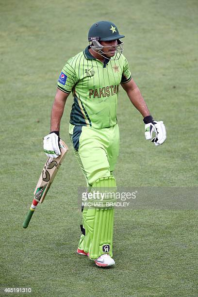 Pakistan's Nasir Jamshed walks off after being dismissed for four runs during the Pool B Cricket World Cup match between the United Arab Emirates and...