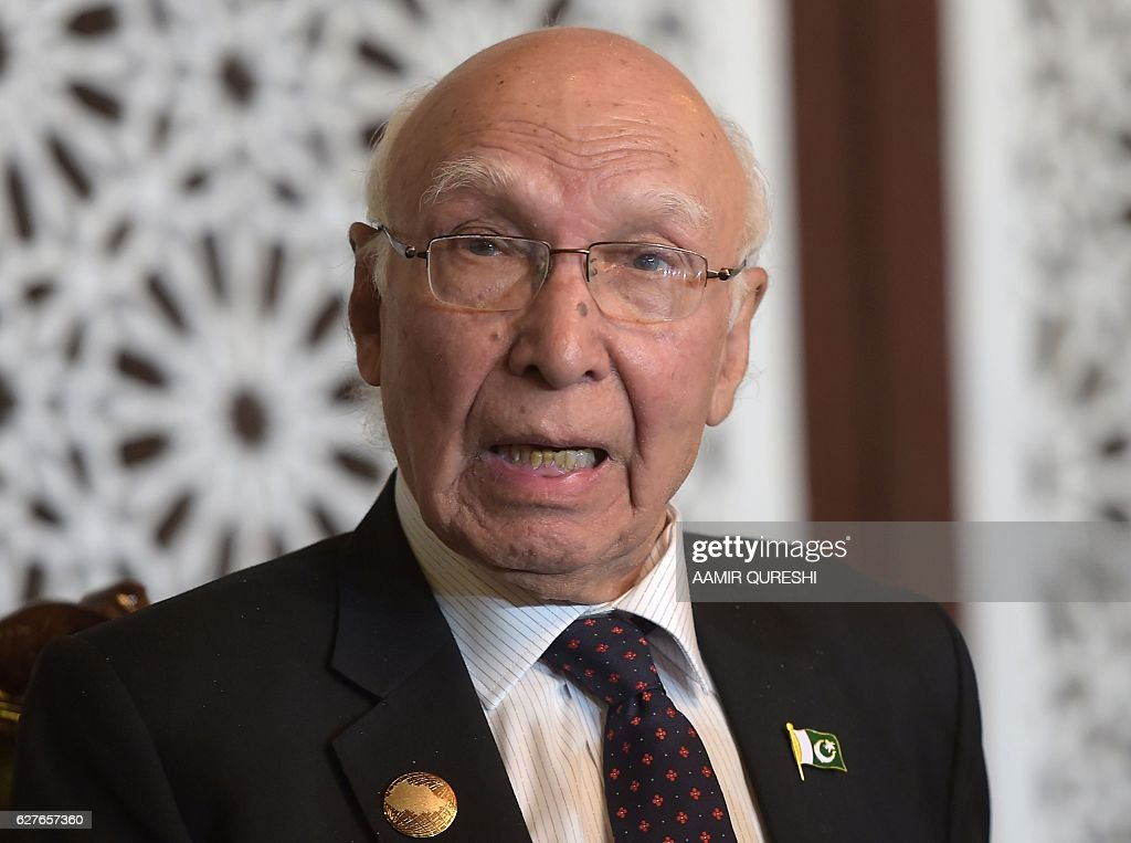Pakistan`s National Security Advisor Sartaj Aziz speaks during a news conference at the Foreign Ministry in Islamabad on December 4 after attending...