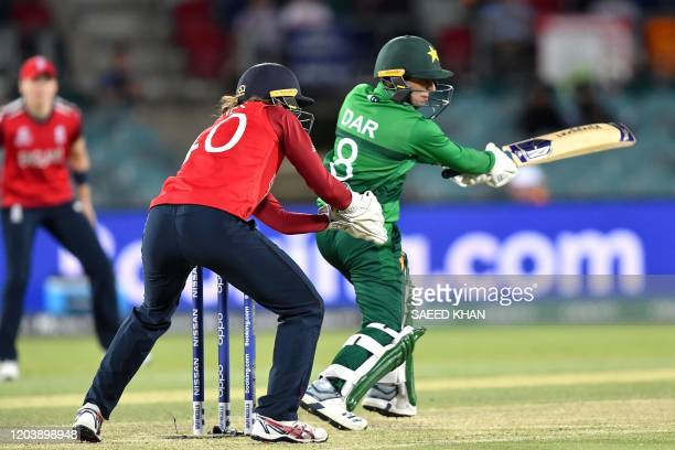 Pakistan's Nida Dar fails to play a shot during the Twenty20 women's World Cup cricket match between Pakistan and England in Canberra on February 28...