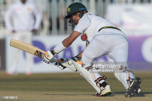 Pakistan's Pakistan's Babar Azam plays a shot during the fifth and final day of the first Test cricket match between Pakistan and Sri Lanka at the...