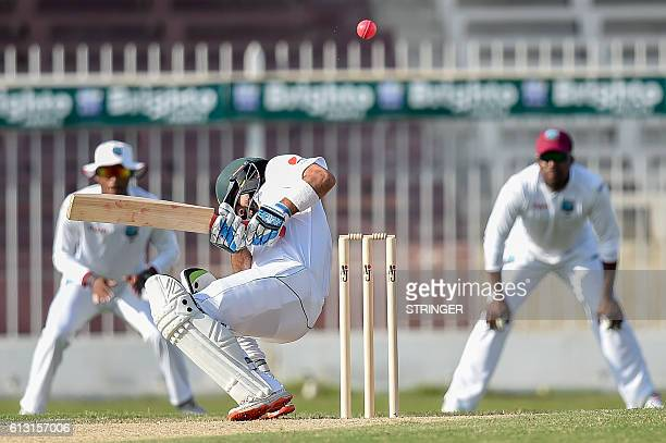 Pakistan's player Ahmed Shahzad ducks a bounce from West Indies bowler Alzarri Joseph during the Pakistan Cricket Board Patron's XI x the West Indies...