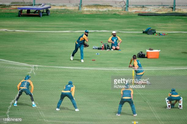 Pakistan's players attend a practice session at the National Stadium in Karachi on January 23 ahead of their first cricket test match against South...
