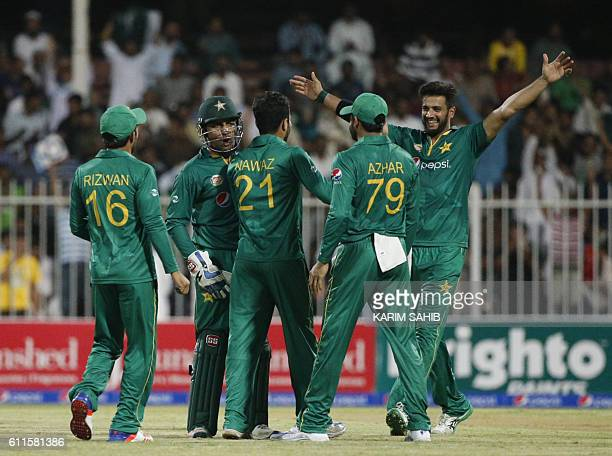 Pakistan's players celebrate after bowling out West Indies' batsman during the 1st ODI match between Pakistan and West Indies at the Sharjah Cricket...