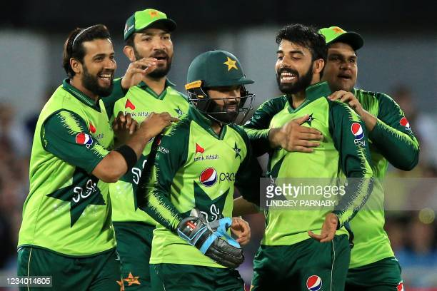 Pakistan's players celebrate after England's Liam Livingstone is caught out during the T20 cricket match between England and Pakistan at Trent...