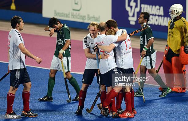 Pakistan's players Muhammad Rizwan and Rashid Mehmood look on as Britain's players celebrate a goal during their match at the Sultan Azlan Shah Cup...